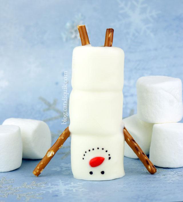Handstand snowman of marshmallow.