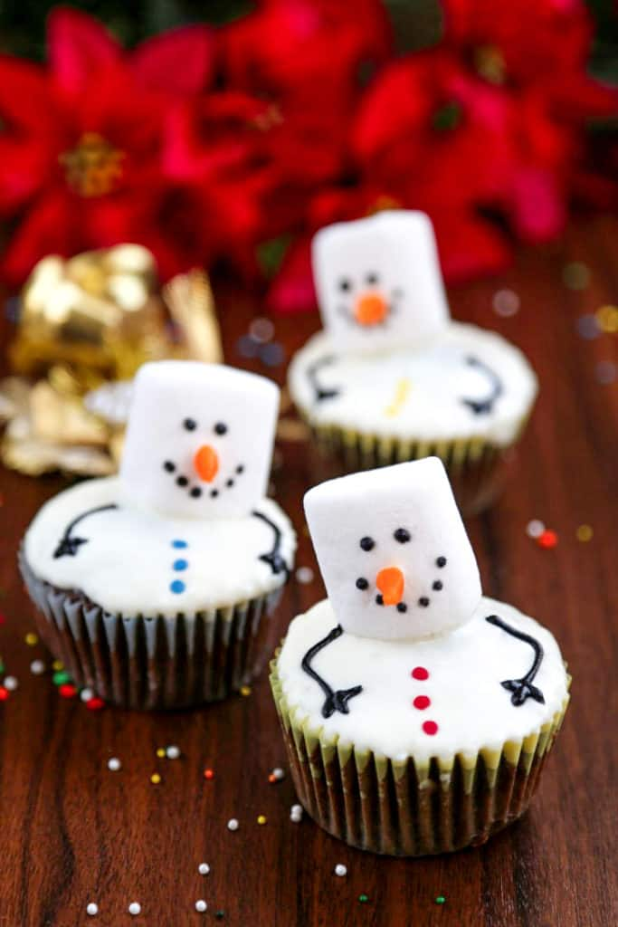 Marshmallow snowman cupcakes.