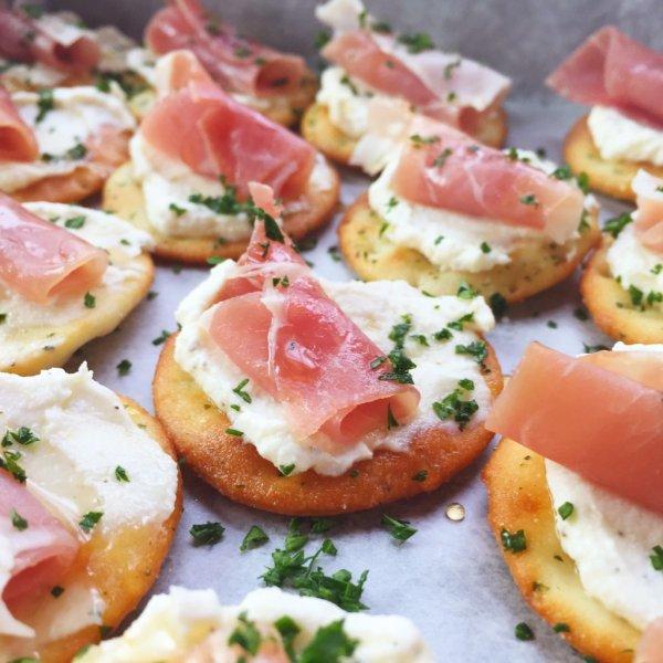 Ricotta and Prosciutto cracker appetizer.