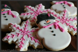 Snowflake and snowman cookies.
