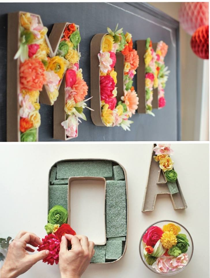 Cardboard letter filled with flowers.