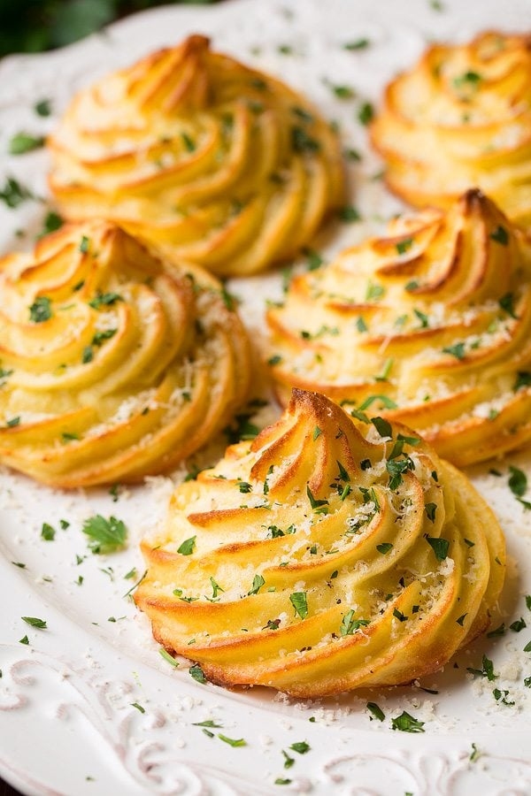 Duchess Potatoes with Garlic and Parmesan Cheese.