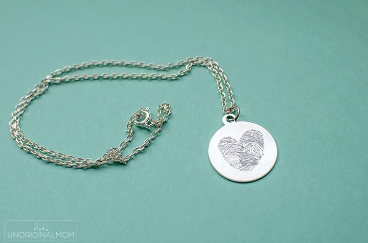 Etched fingerprint necklace.