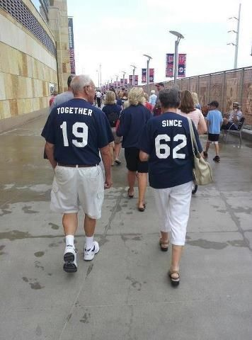 Matching jerseys of together and since for couple.
