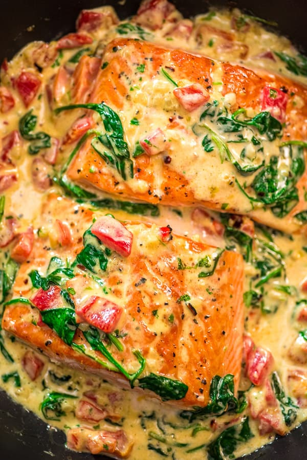 Salmon in roasted pepper sauce.